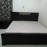 a) Home Centre pure wood King Size Bed set with 2 side tables 1 dresser and Mattress for AED:900/-.